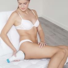 Mujer con masajeador Glo 910+